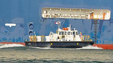 Crew transferring to underway freighter